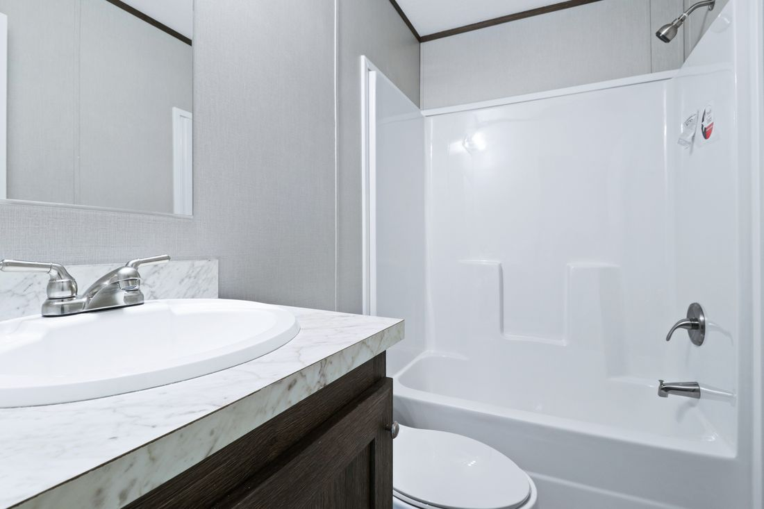 The DECISION MAKER 16763B Guest Bathroom. This Manufactured Mobile Home features 3 bedrooms and 2 baths.