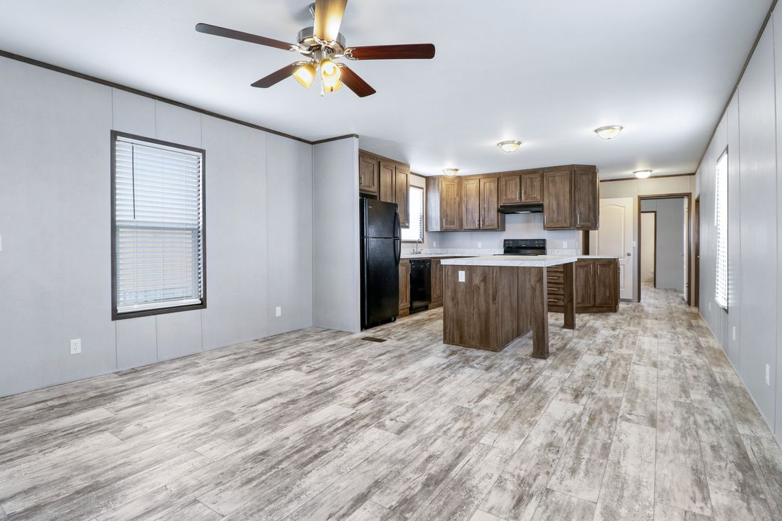 The DECISION MAKER 16763B Living Room. This Manufactured Mobile Home features 3 bedrooms and 2 baths.