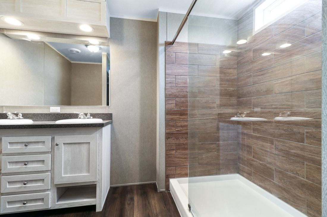 The DECISION MAKER 16803W Master Bathroom. This Manufactured Mobile Home features 3 bedrooms and 2 baths.