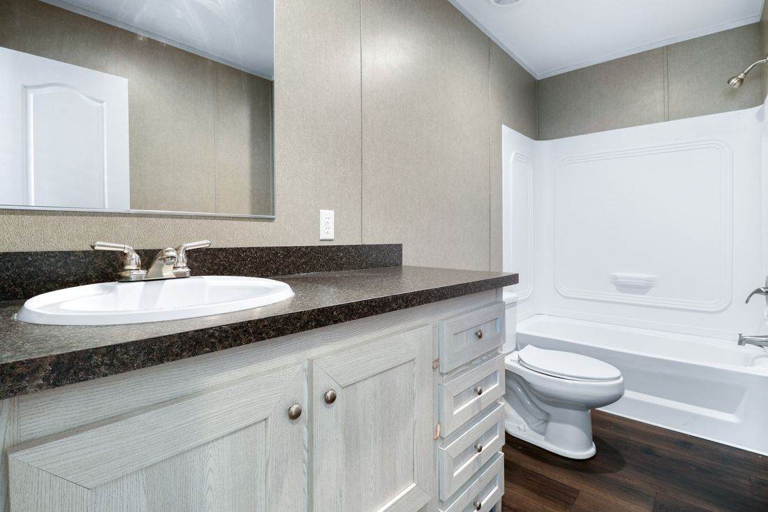 The DECISION MAKER 16803W Guest Bathroom. This Manufactured Mobile Home features 3 bedrooms and 2 baths.