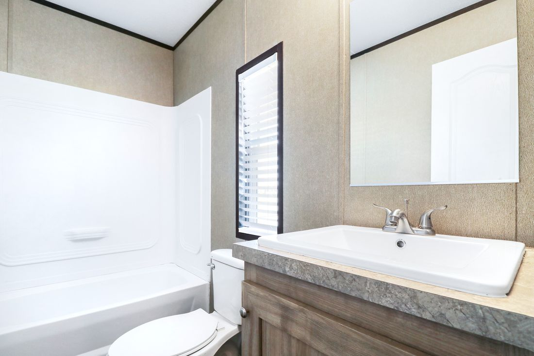 The ANNIVERSARY 16682A Guest Bathroom. This Manufactured Mobile Home features 2 bedrooms and 2 baths.