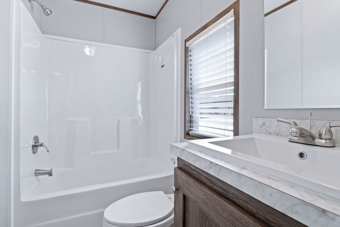 The DECISION MAKER 16764F Guest Bathroom. This Manufactured Mobile Home features 4 bedrooms and 2 baths.