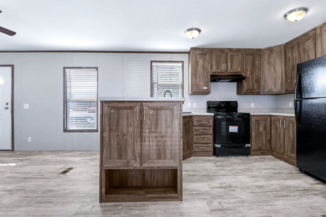 The DECISION MAKER 16764F Kitchen. This Manufactured Mobile Home features 4 bedrooms and 2 baths.