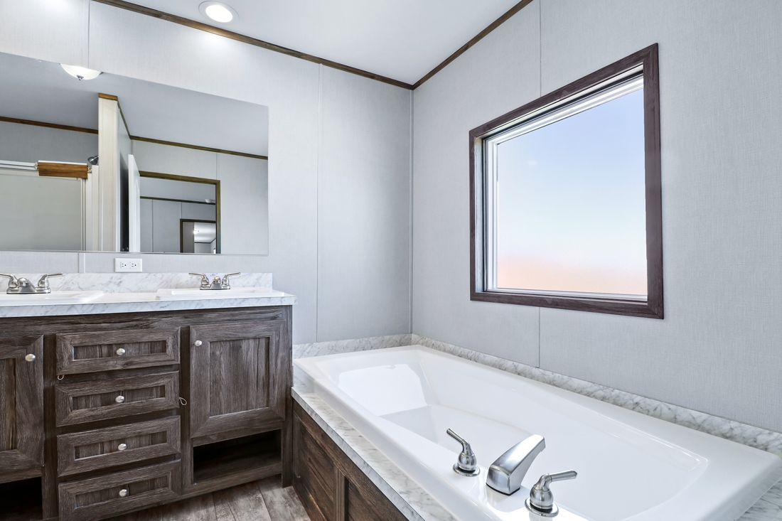 The DECISION MAKER 16764F Master Bathroom. This Manufactured Mobile Home features 4 bedrooms and 2 baths.