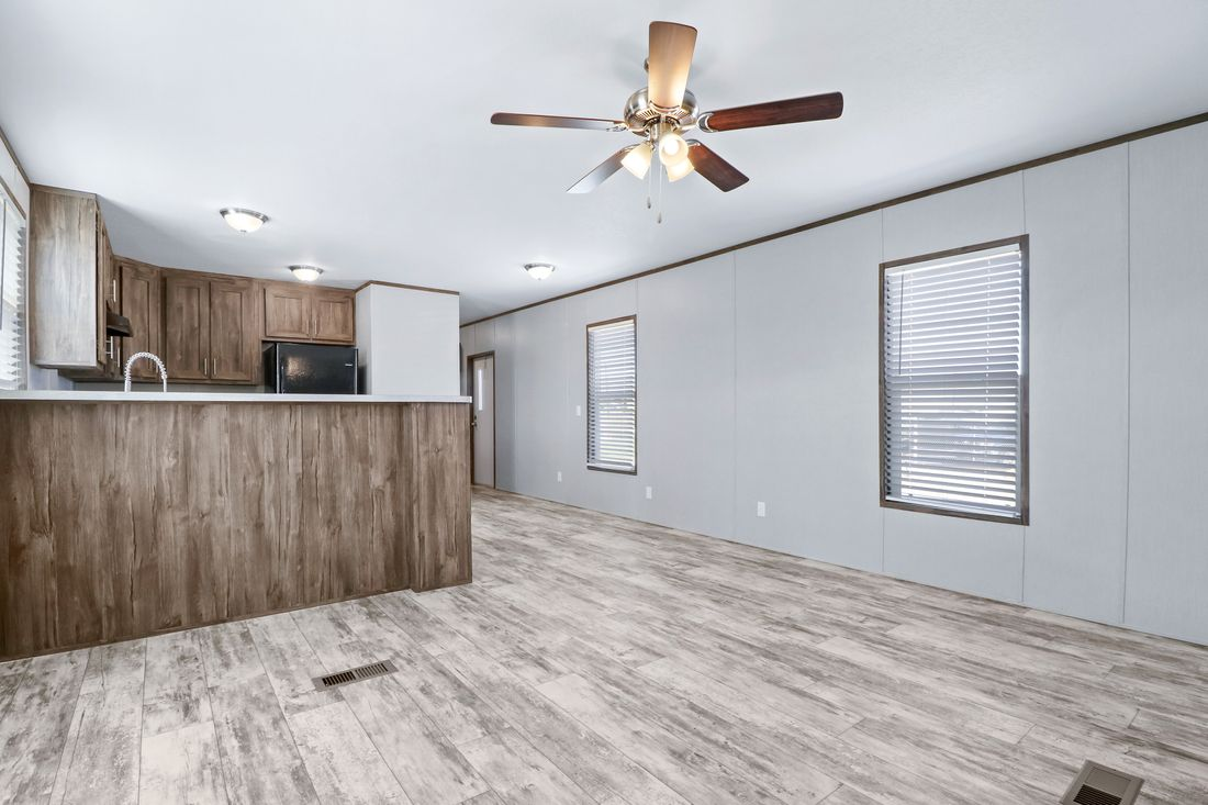 The DECISION MAKER 16764F Living Room. This Manufactured Mobile Home features 4 bedrooms and 2 baths.