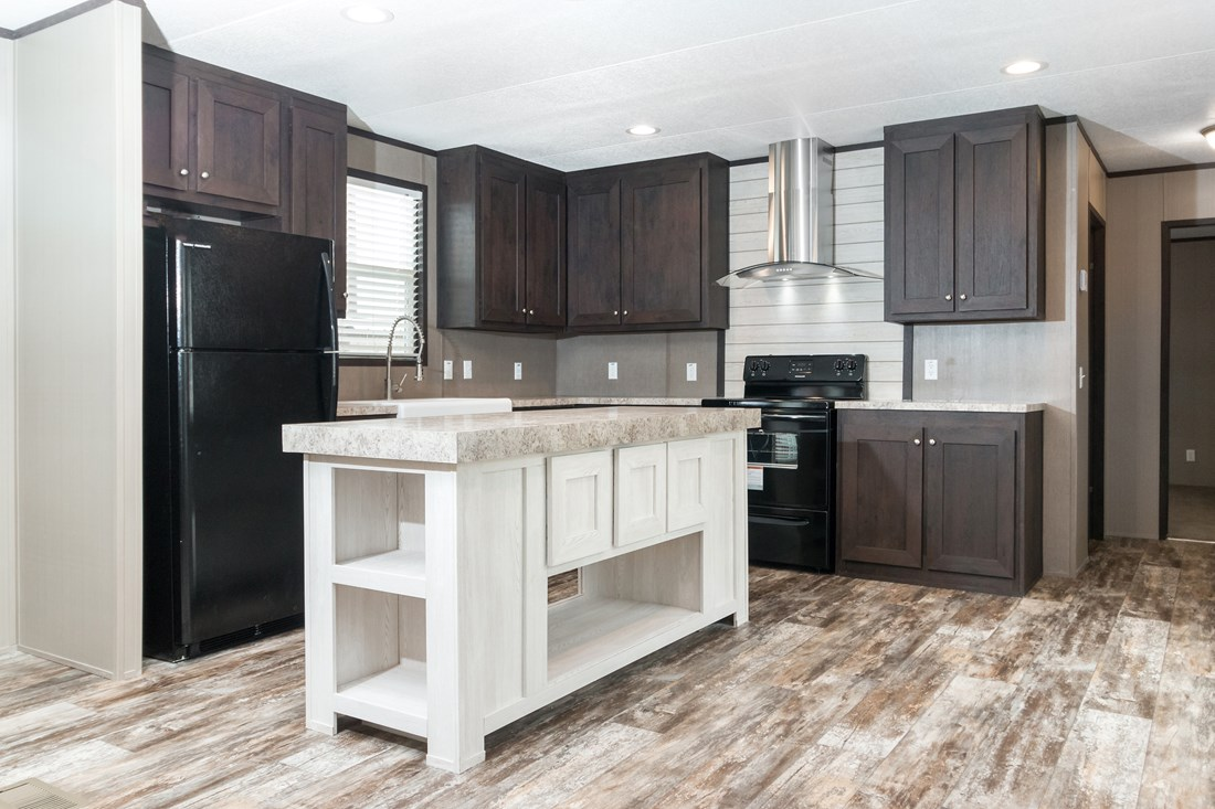The ANNIVERSARY 16763I Kitchen. This Manufactured Mobile Home features 3 bedrooms and 2 baths.
