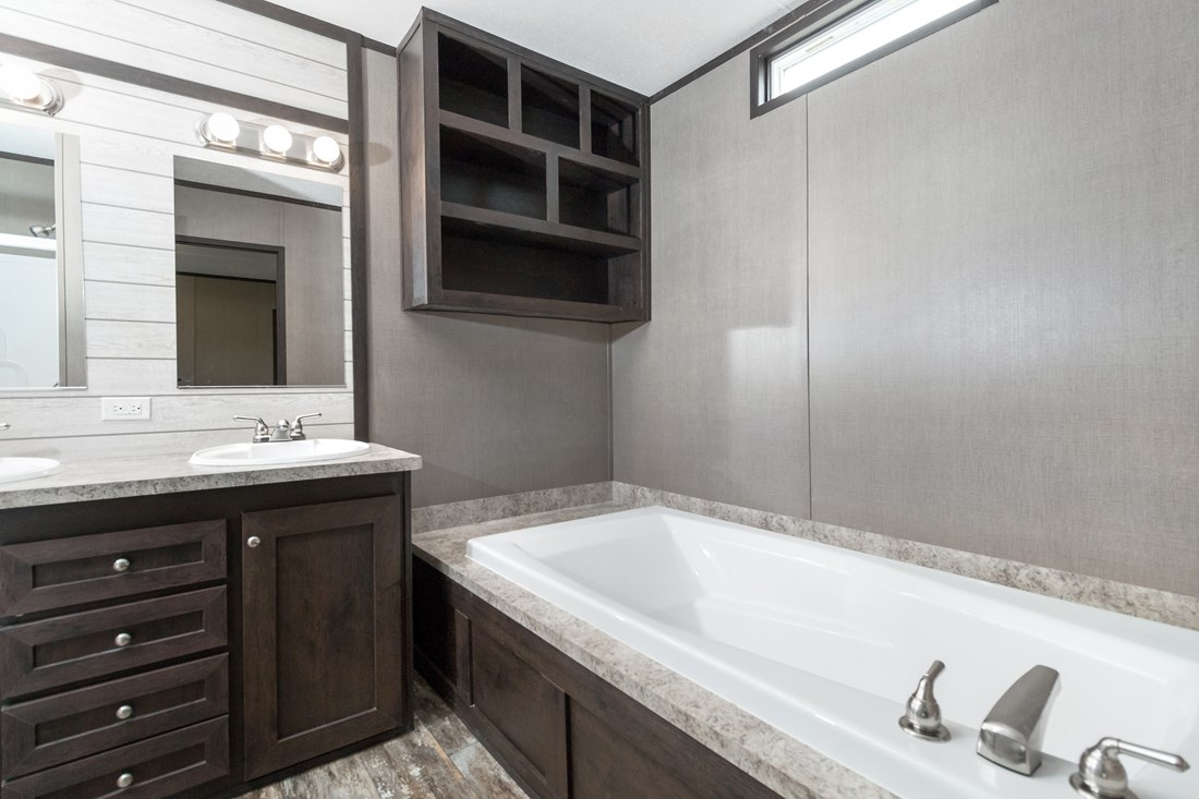 The ANNIVERSARY 16763I Master Bathroom. This Manufactured Mobile Home features 3 bedrooms and 2 baths.