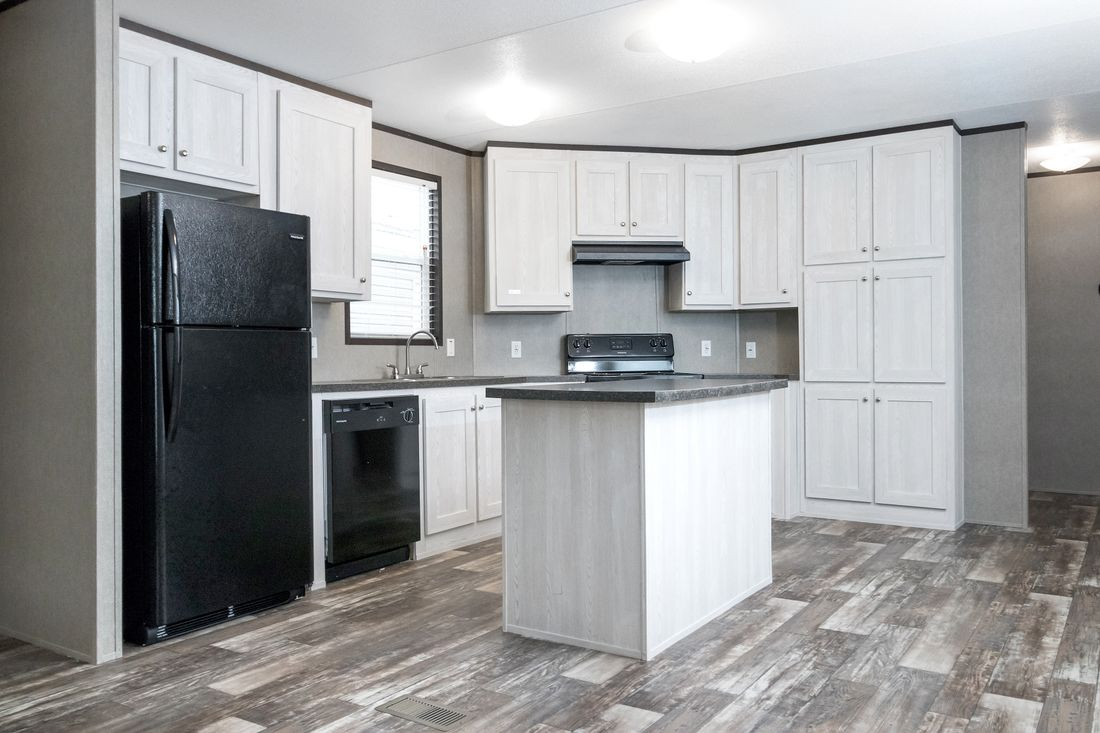 The CHALLENGER 16763B Kitchen. This Manufactured Mobile Home features 3 bedrooms and 2 baths.