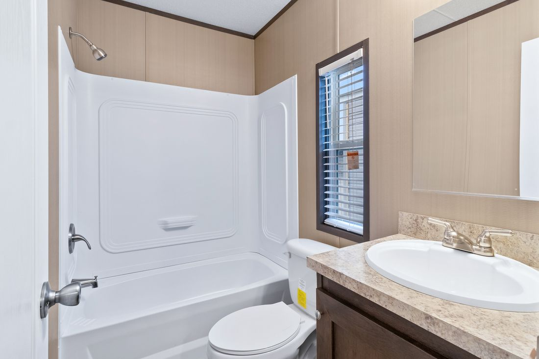 The ANNIVERSARY 16683B Guest Bathroom. This Manufactured Mobile Home features 3 bedrooms and 2 baths.