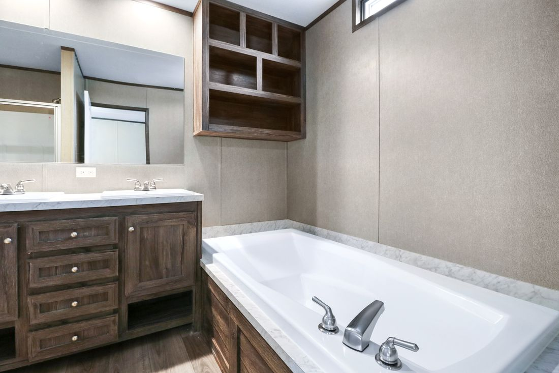The ANNIVERSARY 16683B Master Bathroom. This Manufactured Mobile Home features 3 bedrooms and 2 baths.
