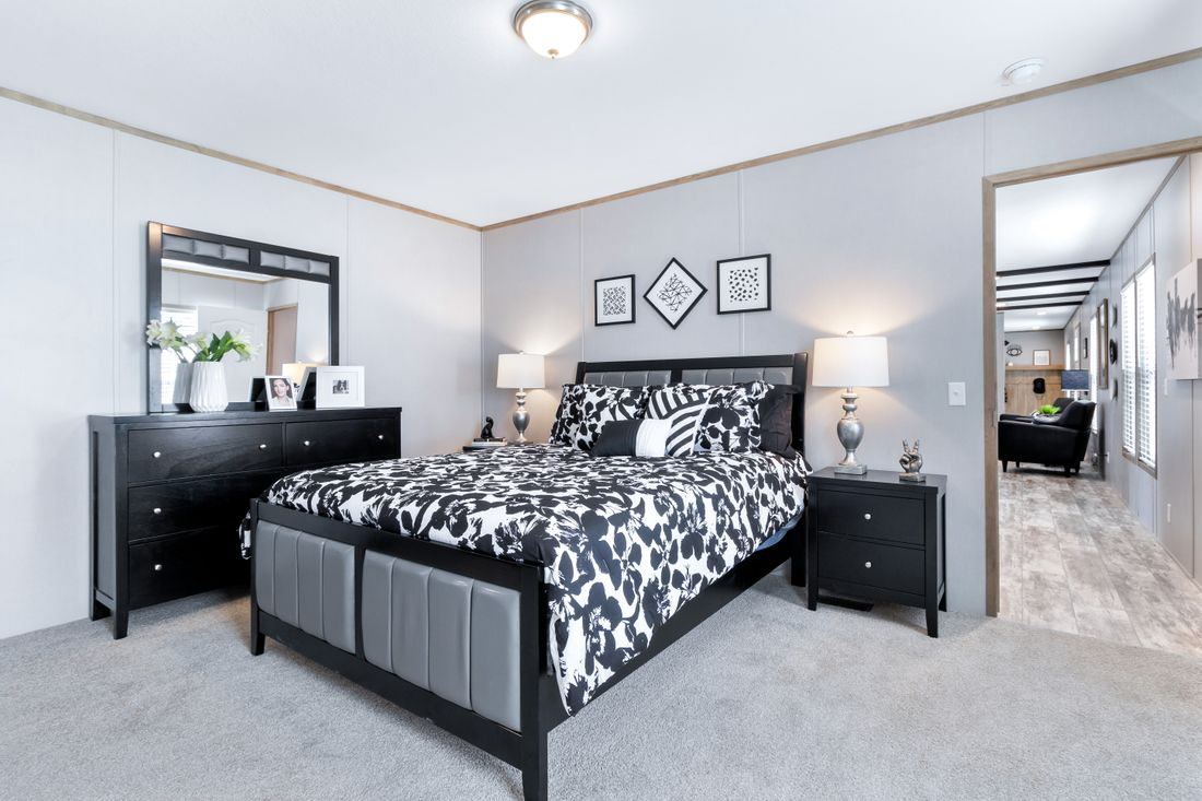 The INSPIRATION 16803A Master Bedroom. This Manufactured Mobile Home features 3 bedrooms and 2 baths.