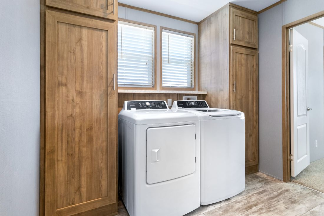 The INSPIRATION 16803A Utility Room. This Manufactured Mobile Home features 3 bedrooms and 2 baths.