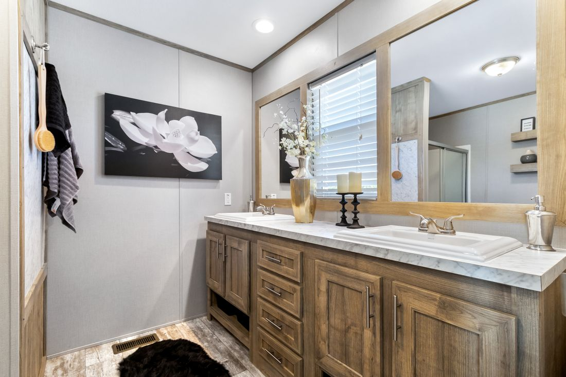 The INSPIRATION 16803A Master Bathroom. This Manufactured Mobile Home features 3 bedrooms and 2 baths.