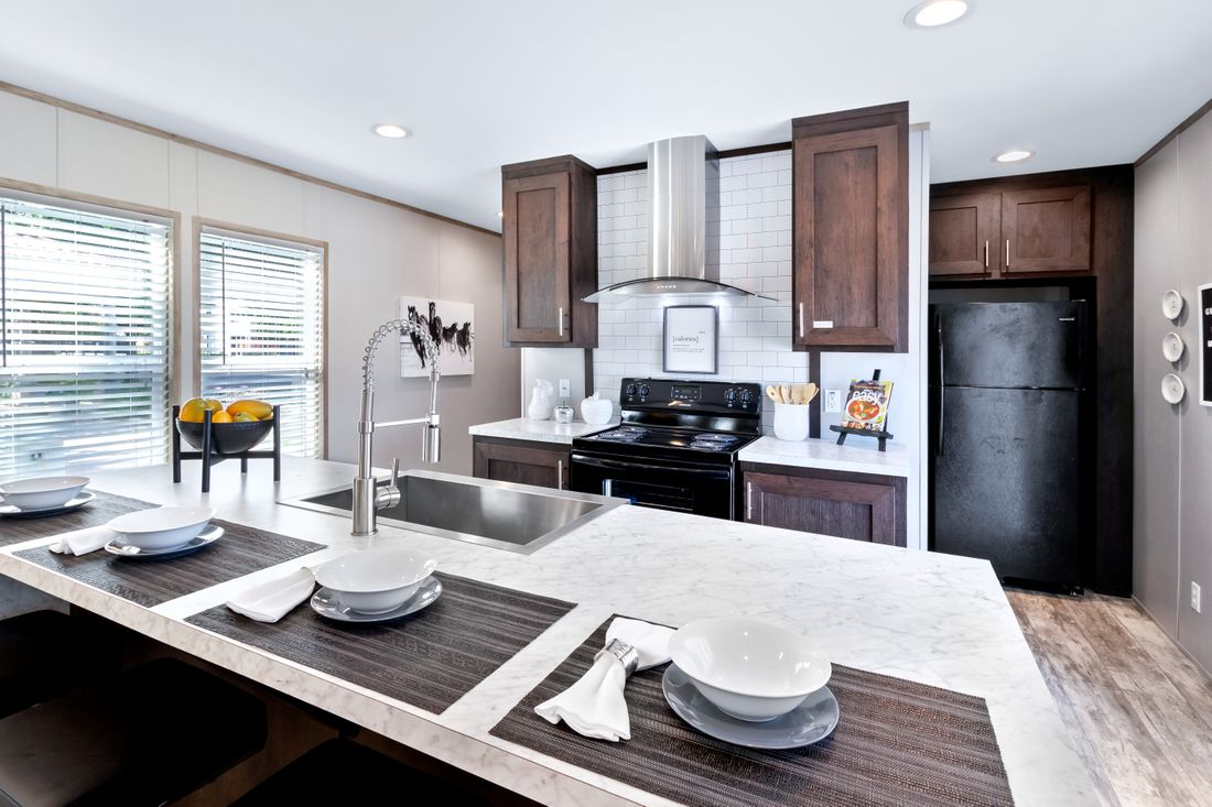 The INSPIRATION 16803A Kitchen. This Manufactured Mobile Home features 3 bedrooms and 2 baths.