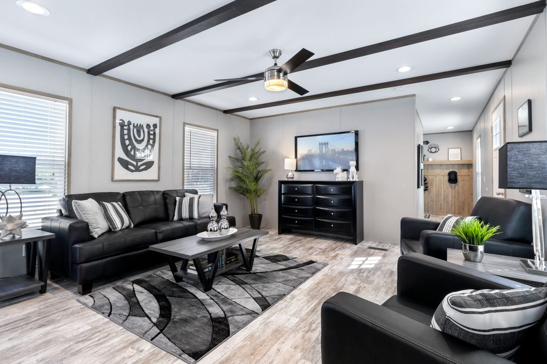 The INSPIRATION 16803A Living Room. This Manufactured Mobile Home features 3 bedrooms and 2 baths.