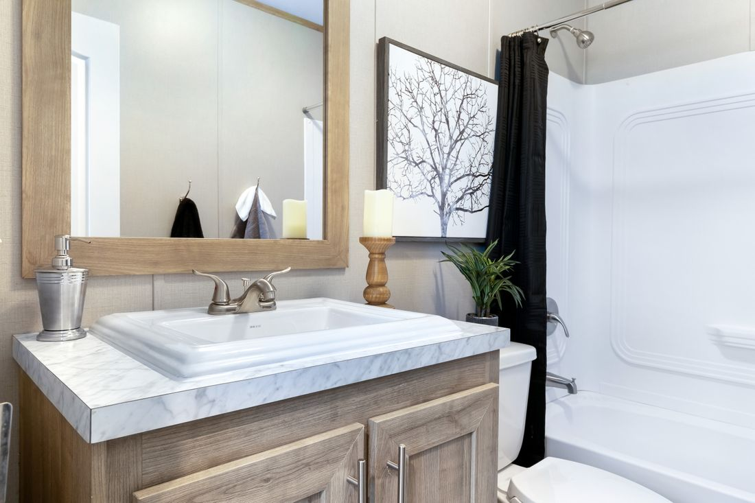 The INSPIRATION 16803A Guest Bathroom. This Manufactured Mobile Home features 3 bedrooms and 2 baths.