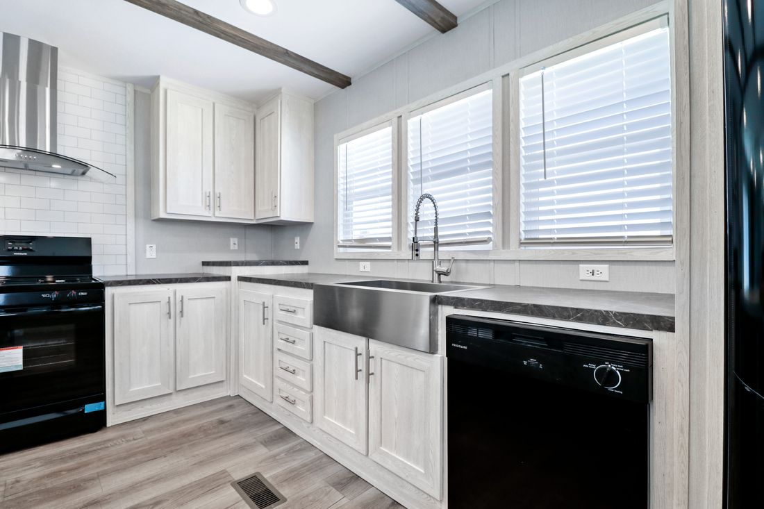 The INSPIRATION 16763K Kitchen. This Manufactured Mobile Home features 3 bedrooms and 2 baths.