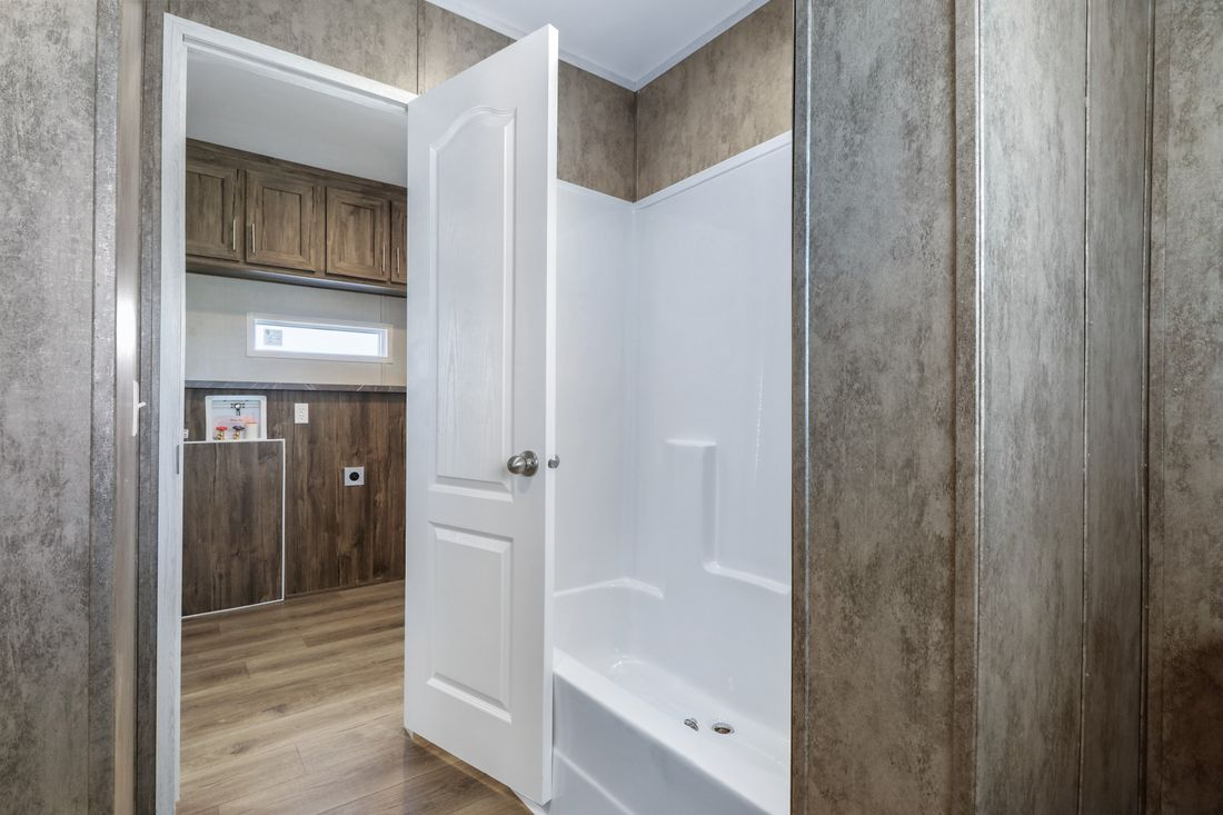 The INSPIRATION 16763K Guest Bathroom. This Manufactured Mobile Home features 3 bedrooms and 2 baths.