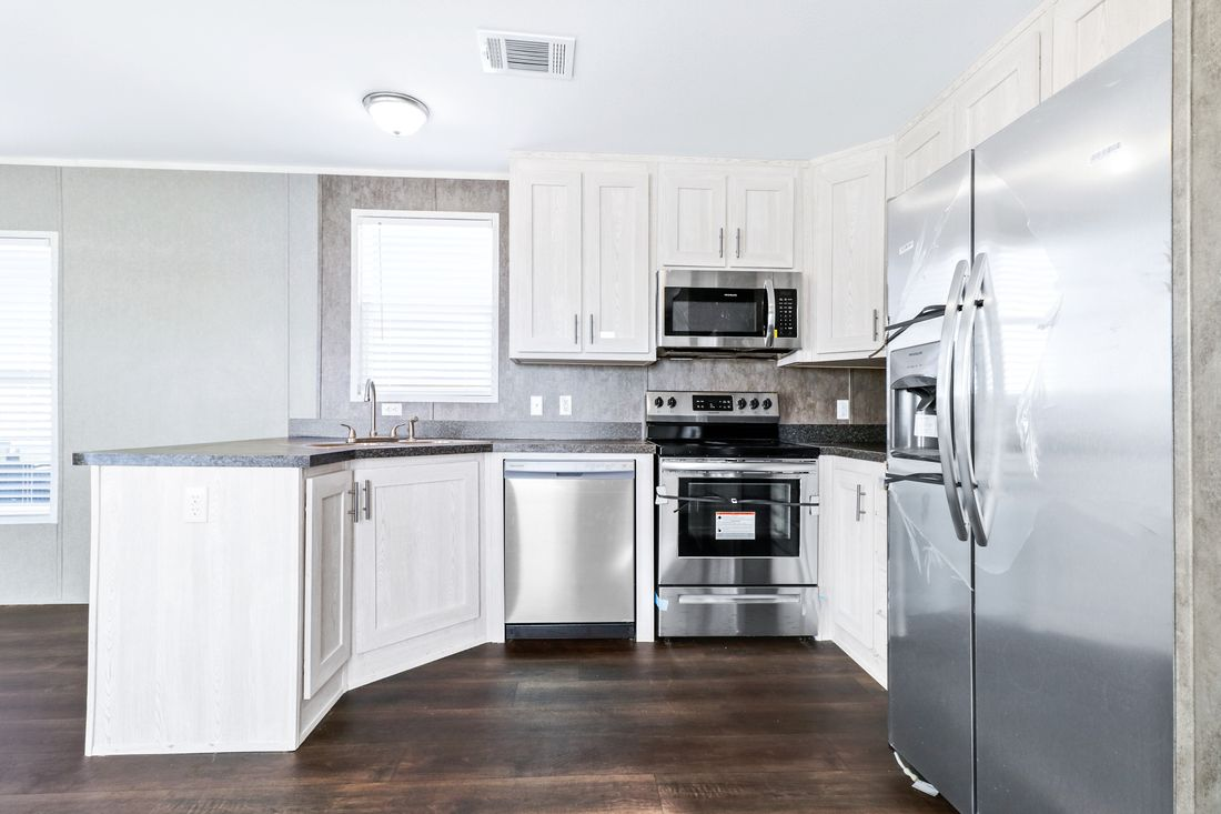 The DECISION MAKER 16603B Kitchen. This Manufactured Mobile Home features 3 bedrooms and 2 baths.