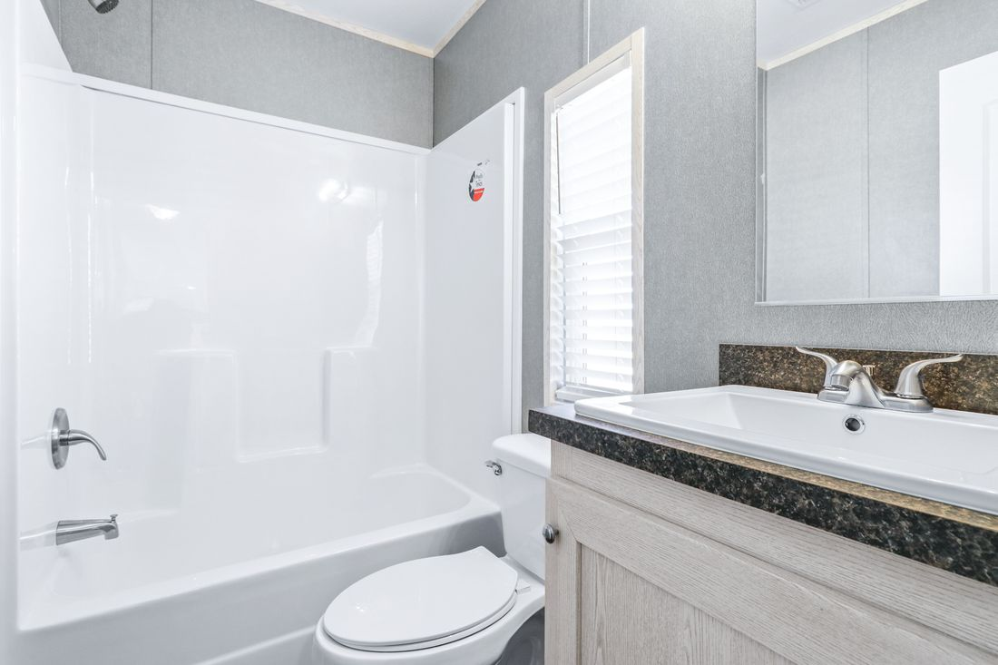 The DECISION MAKER 16603B Guest Bathroom. This Manufactured Mobile Home features 3 bedrooms and 2 baths.