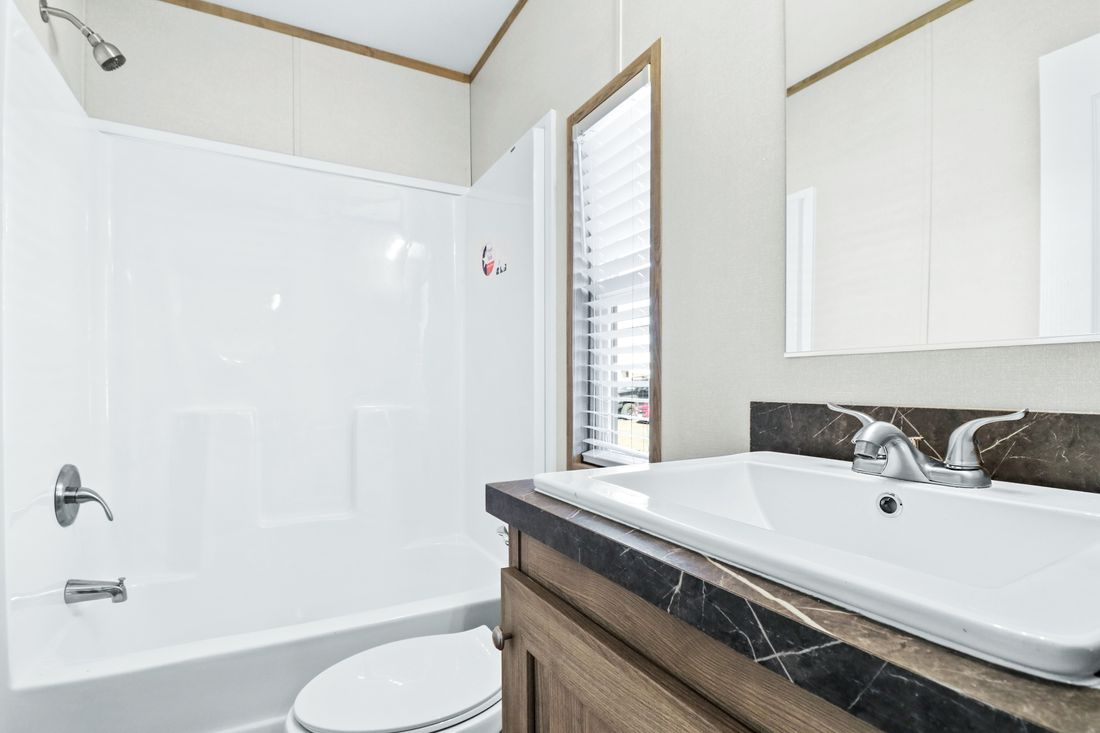 The DECISION MAKER 16683A Guest Bathroom. This Manufactured Mobile Home features 3 bedrooms and 2 baths.
