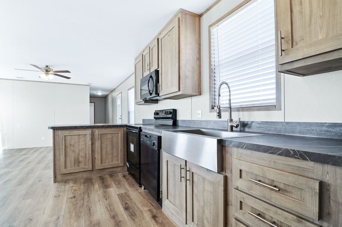 The DECISION MAKER 16683A Kitchen. This Manufactured Mobile Home features 3 bedrooms and 2 baths.