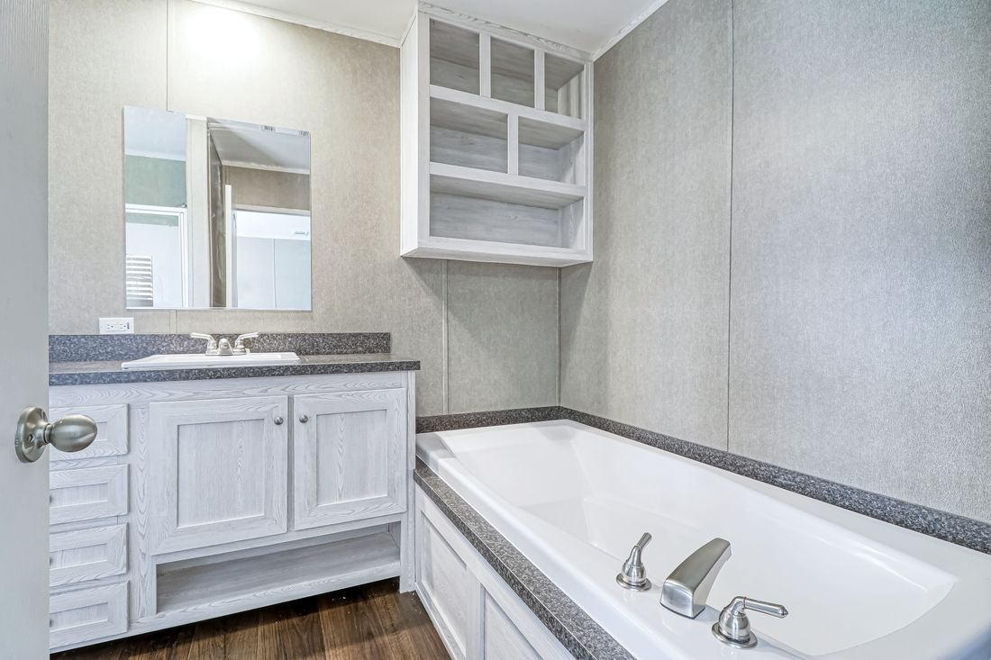 The DECISION MAKER 16763A Master Bathroom. This Manufactured Mobile Home features 3 bedrooms and 2 baths.